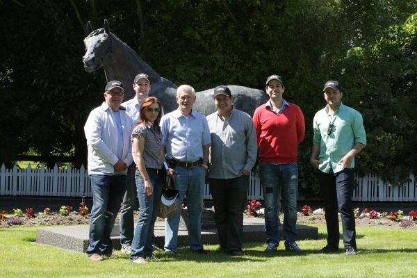 A number of Australia's racing media with Sir Patrick Hogan in front of Sir Tristram's statue at Cambridge Stud